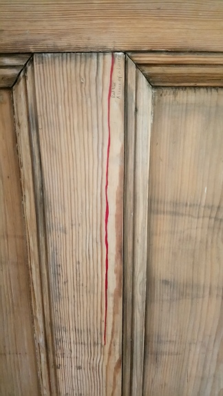 Image of a red line on the door